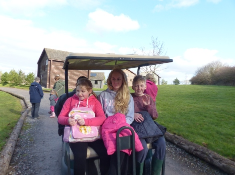 On the golf buggy