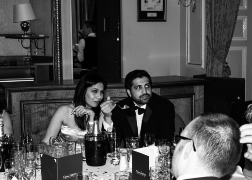 Hazel and Alpesh enjoying the food and fizz!