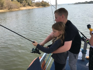 Sibling assistance with fishing