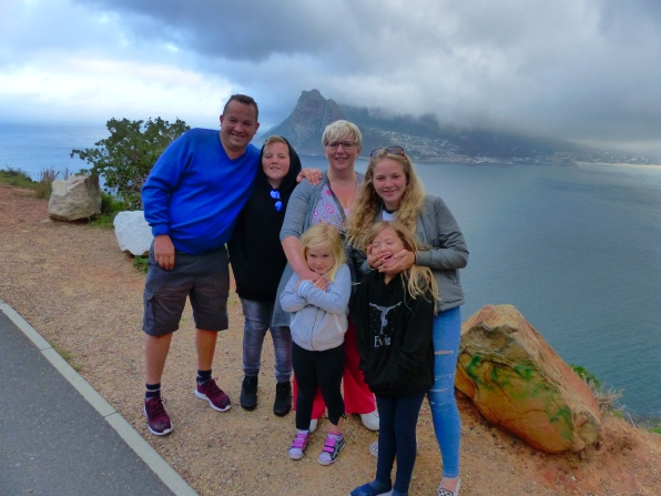 Team Price in front of Chapman's Peak